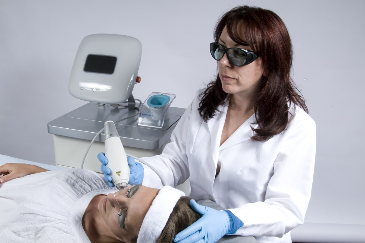 Nurse applying Clear + Brilliant™ to patient.