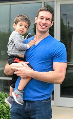 Dr. Ryan Riahi holding his son