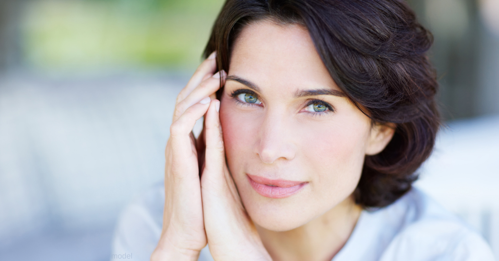 Woman in her 40s, poses with flawless, smooth skin from BOTOX